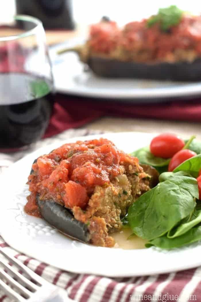 Stuffed Eggplant | Delicious eggplant stuffed with spicy sausage and topped with homemade red sauce!