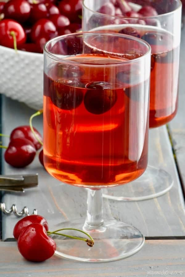a glass of cherry sangria