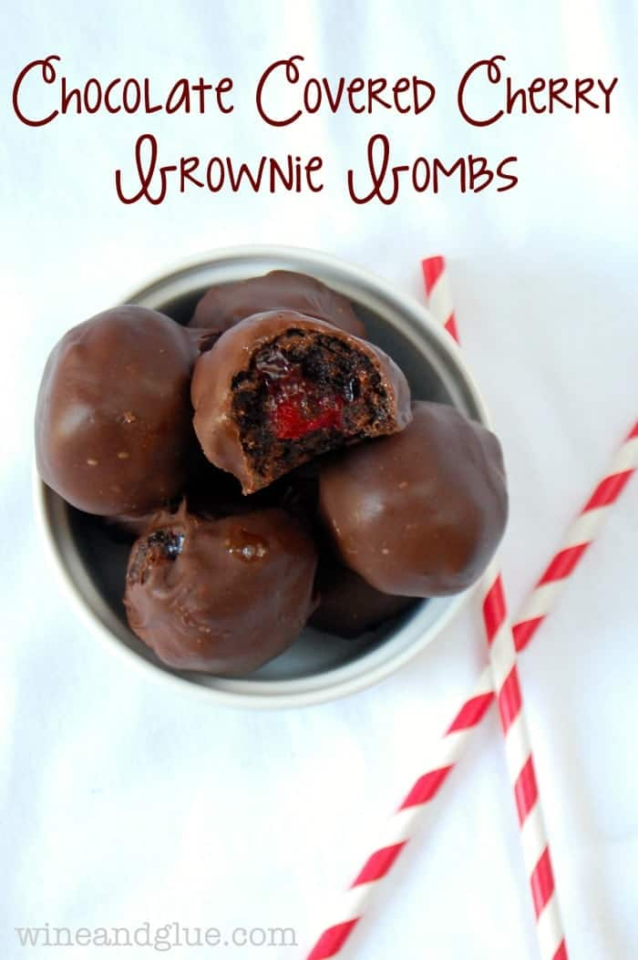 Chocolate Covered Cherry Brownie Bombs! Delicious bites of brownie surrounding cherry pie filling and then dipped in chocolate! via www.wineandglue.com
