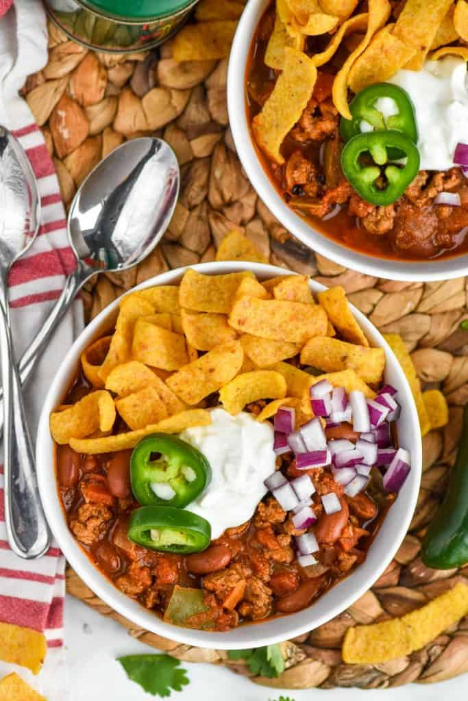 overhead view of a bowl of the best turkey chili pilled with toppings