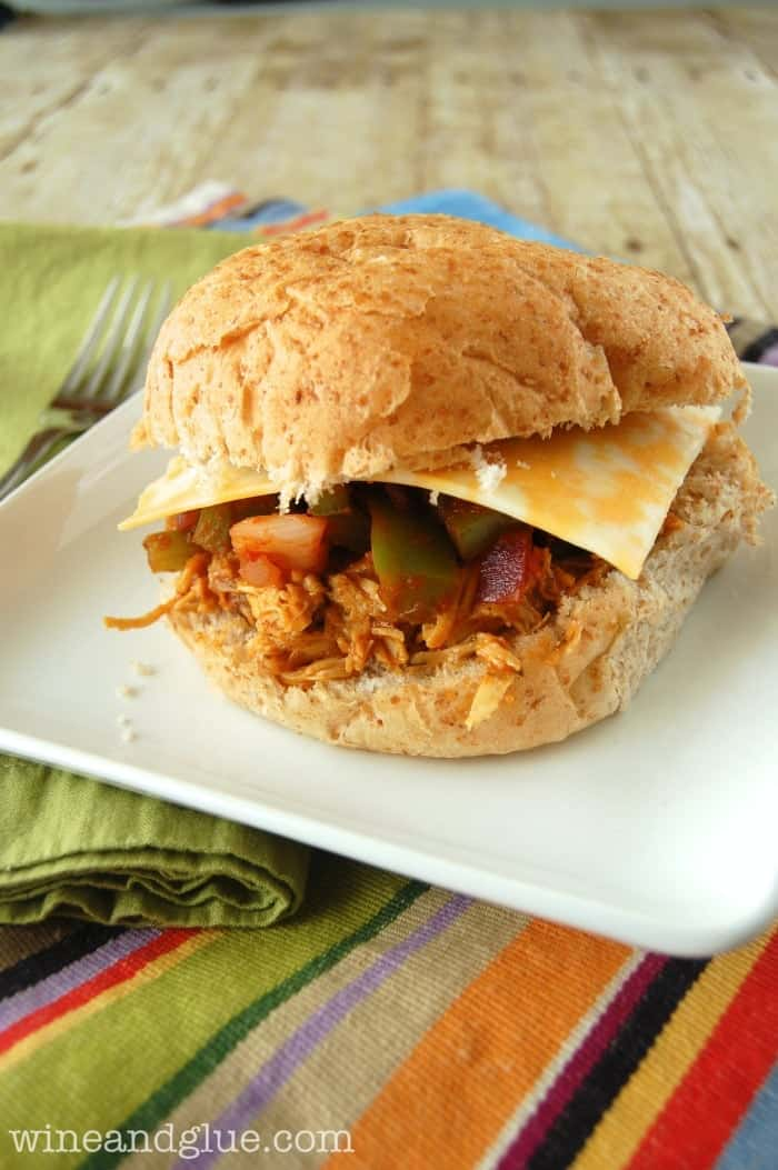 Slow Cooker Tex Mex Pulled Chicken Sammies! An easy meal delicious it will become a regular in your dinner rotation #kraftrecipemakers #shop via www.wineandglue.com