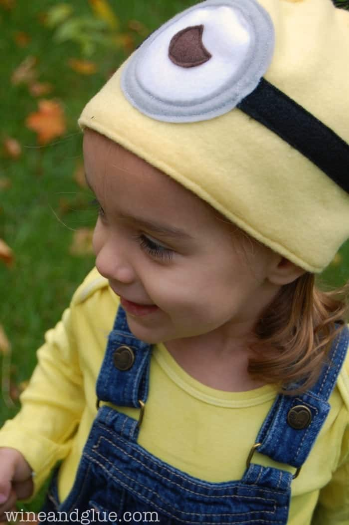 Little girl wearing a homemade Minion Costume and easy to sew Minion hat