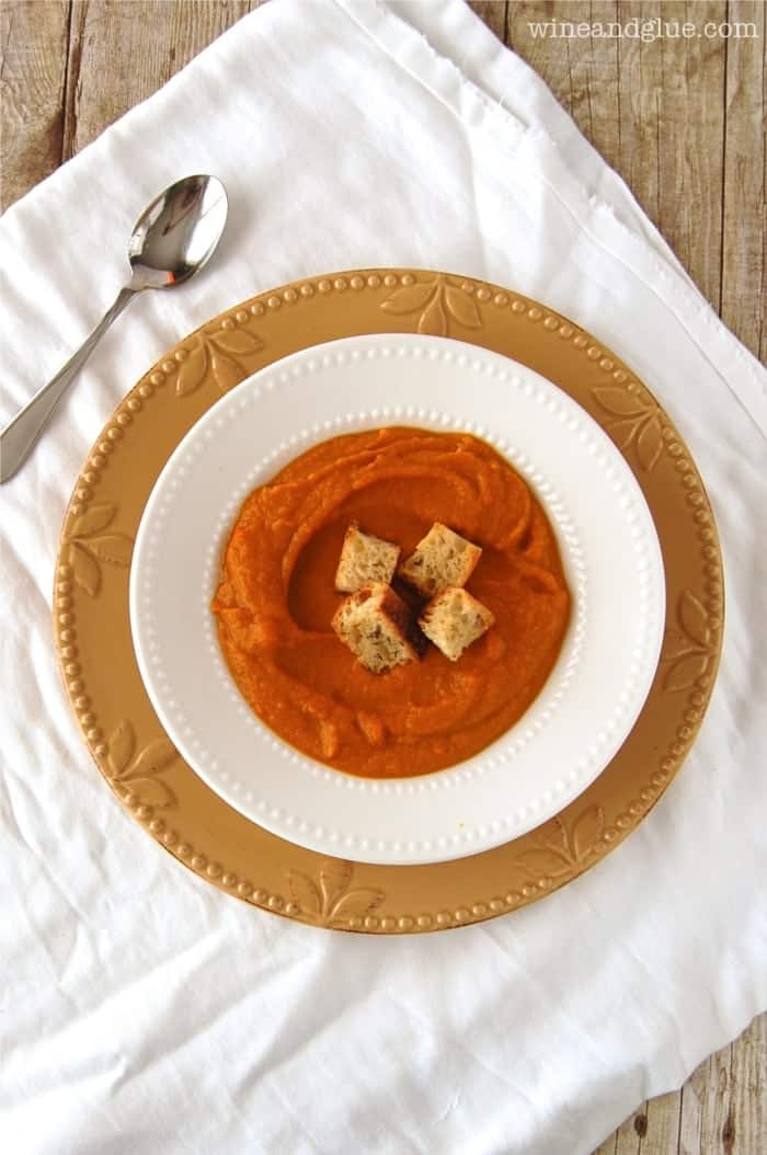 Pumpkin Curry Soup with home made Rosemary Croutons that is so warm and delicious!  Perfect for fall! via www.wineandglue.com