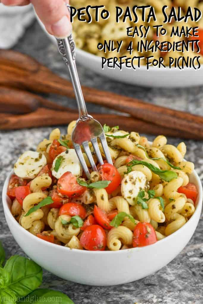 bowl of pesto pasta salad with fork coming out