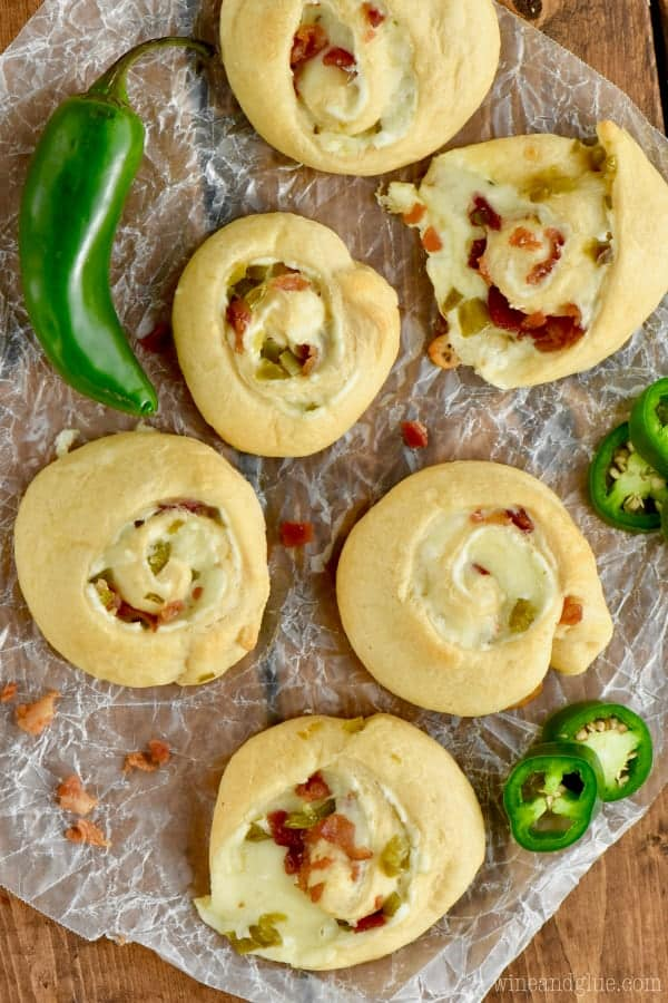 An overhead photo of the the Jalapeno Popper Pinwheels with melted cheese oozing out and minced bacon and jalapenos.