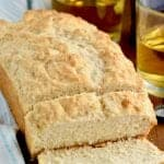 Three Ingredient Beer Bread couldn't be simpler to make! This beer bread recipe is the easiest way to make homemade bread. Watch our video recipe tutorial!