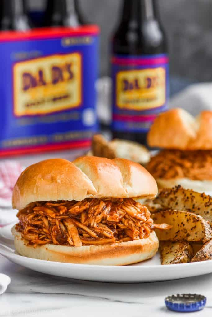 crock pot bbq chicken sandwich on a plate made with root beer