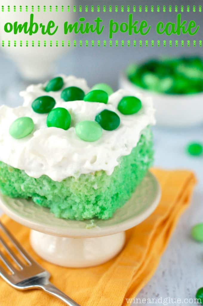 The Ombre Mint Poke Cake has an airy green ombre cake and topped with a fluffy frosting and green colored M&Ms.