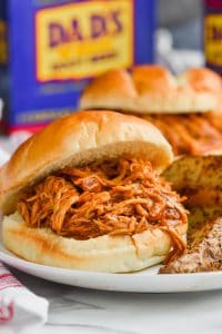 root beer slow cooker bbq chicken sandwich close up on a plate