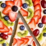 pinterest graphic of overhead view of a close up of a slices of fruit pizza recipe