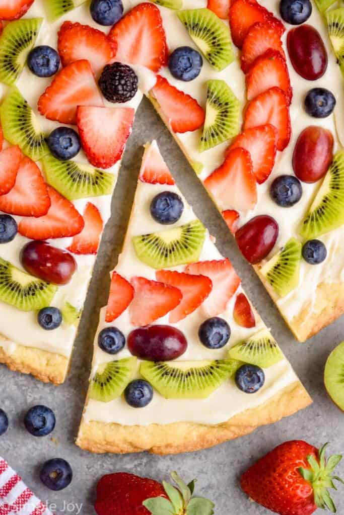 overhead view of a close up of a slices of fruit pizza recipe