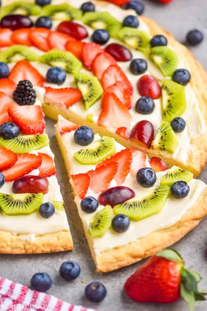 side view of a slice of sugar cookie fruit pizza