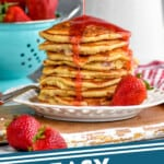 pinterest graphic of strawberry pancake syrup being poured over pancakes