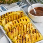 grilled pineapple spears on a platter