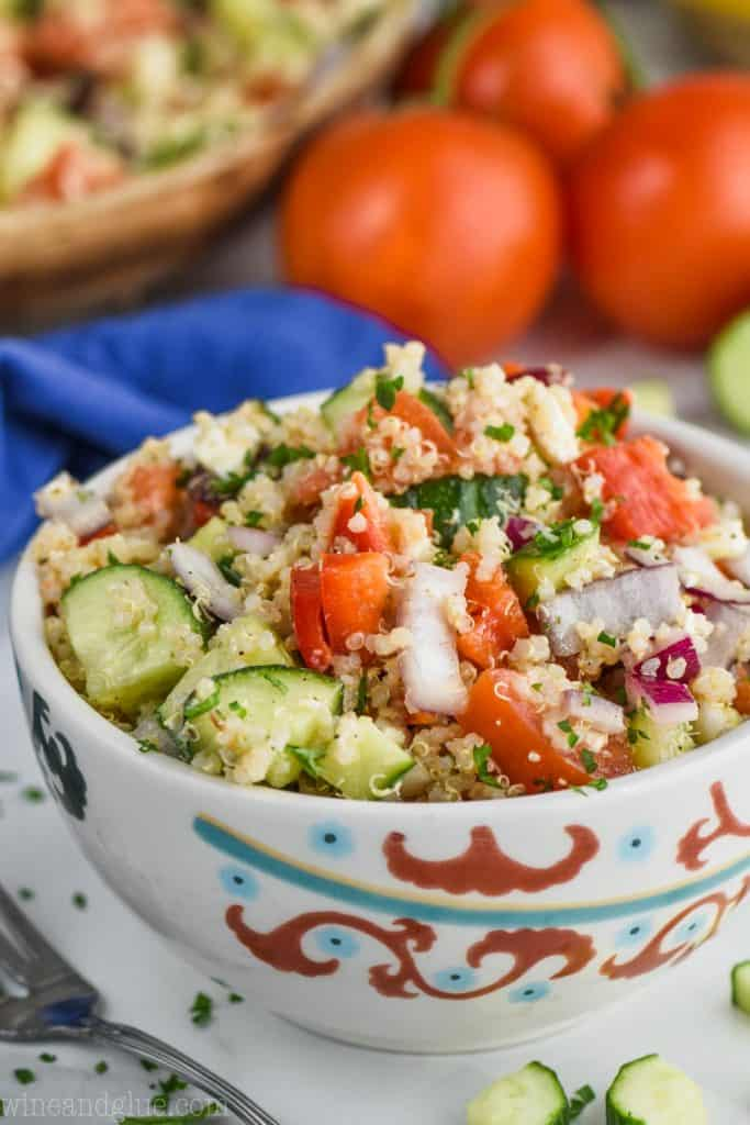 Mediterranean quinoa salad in a decorative white bowl