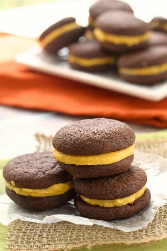 Pumpkin Oreos | www.wineandglue.com | Delicious chocolatey cookies that sandwich perfect with wonderful pumpkin buttercream.