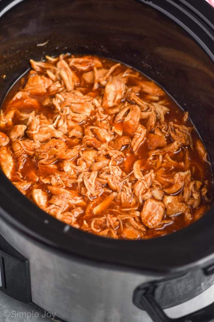 side view of slow cooker bbq chicken in a crockpot