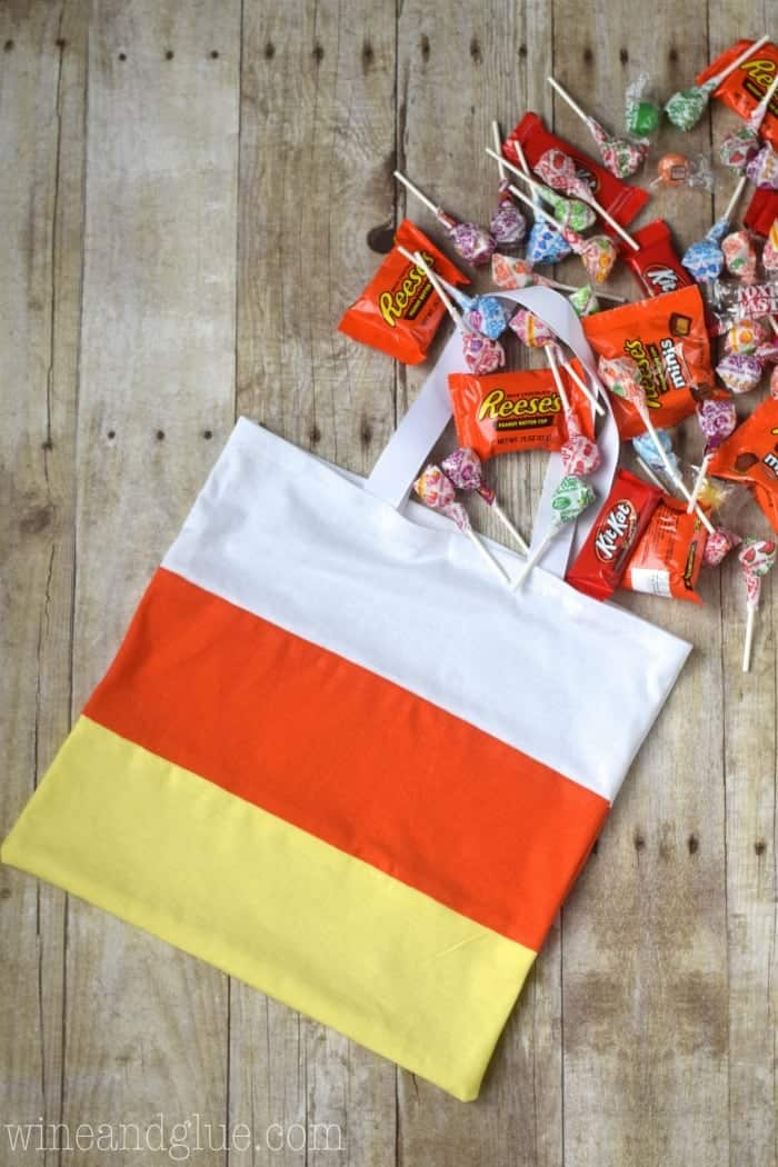 An awesome Dollar Store Candy Corn Treat Bag that is such an easy diy for Halloween that it can be done in under 30 minutes!