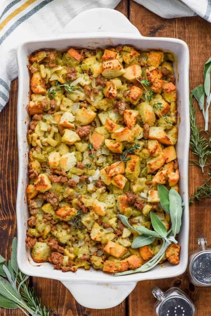 overhead view of the best homemade stuffing recipe garnished with fresh sage