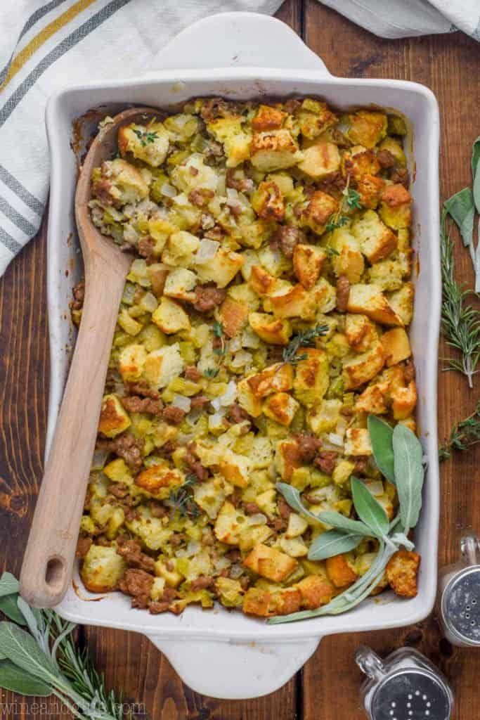 overhead view of sausage stuffing recipe in a 9 by 13 inch baking dish