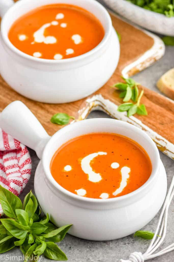 two bowls fo tomato basil bisque