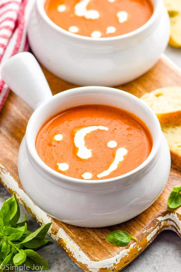 small soup bowl full of tomato bisque with cream drizzled on top
