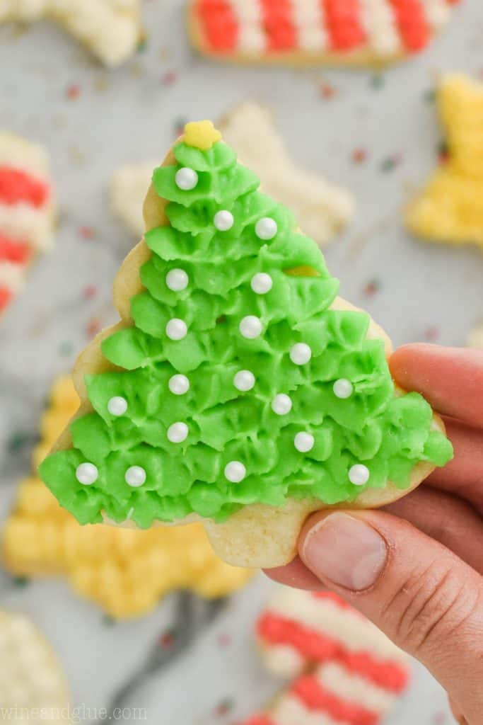 close up of held easy cut out sugar cookie recipe in shape of a christmas tree