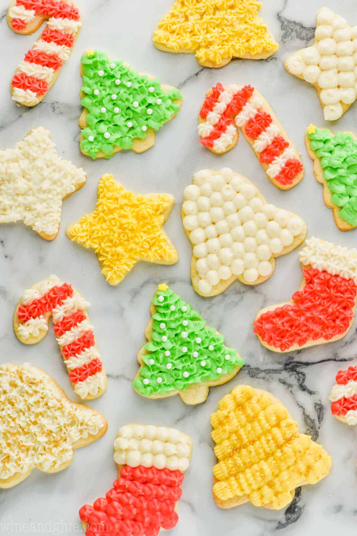 overhead view of a lot of soft cut out sugar cookies that have been frosted and decorated