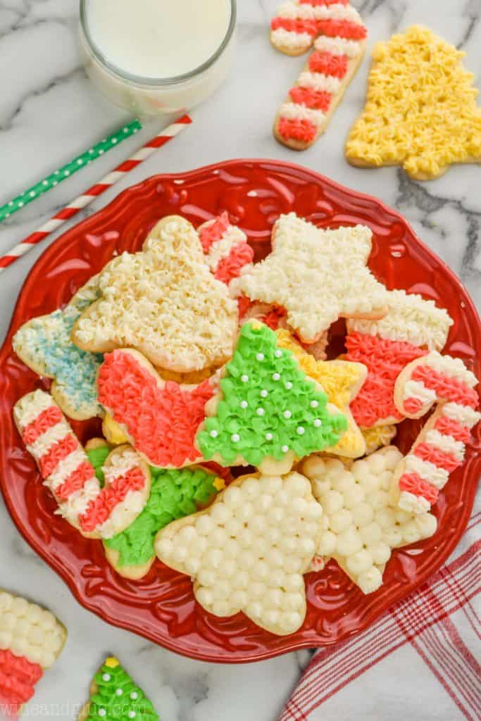 plate of frosted cut out sugar cookies