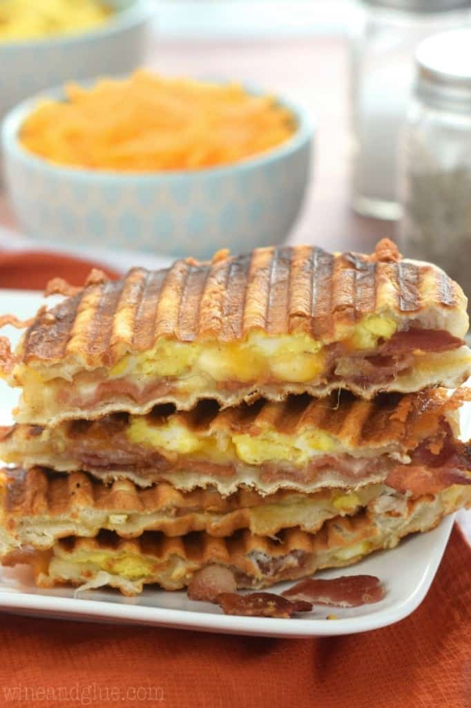 The Bacon, Egg and Biscuit Breakfast Panini has a golden brown crust with cheese oozing out.