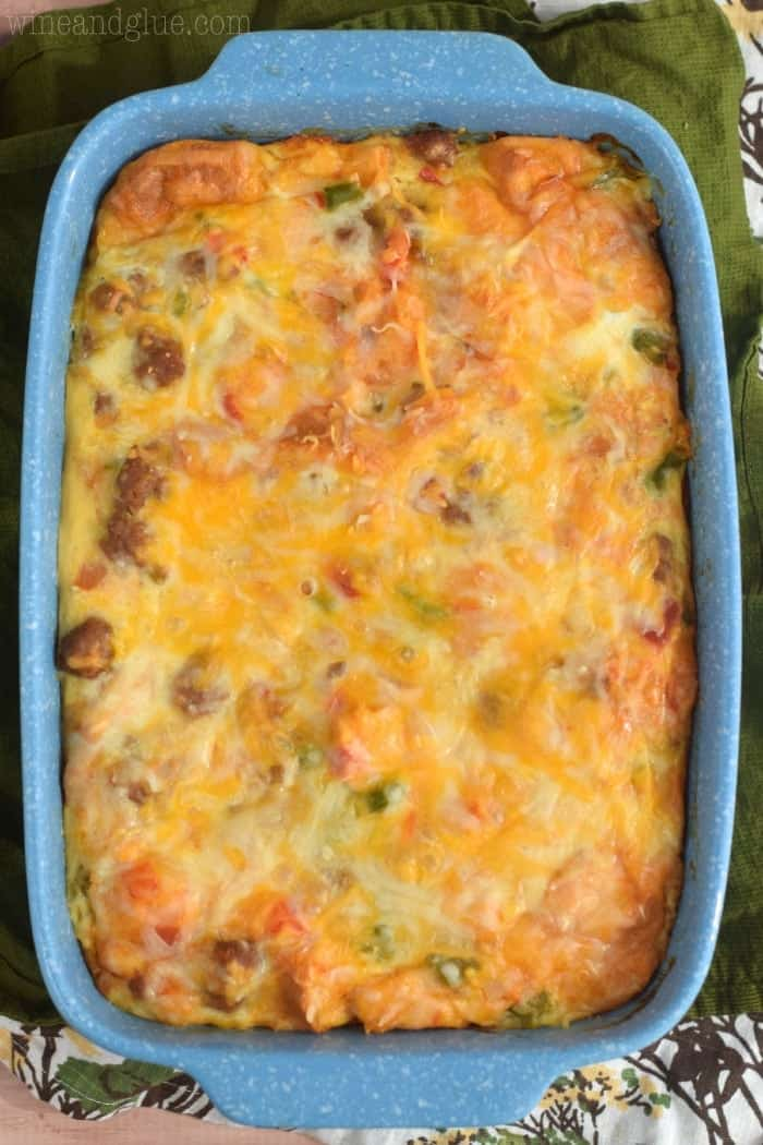 overhead view of a breakfast casserole in a blue casserole dish