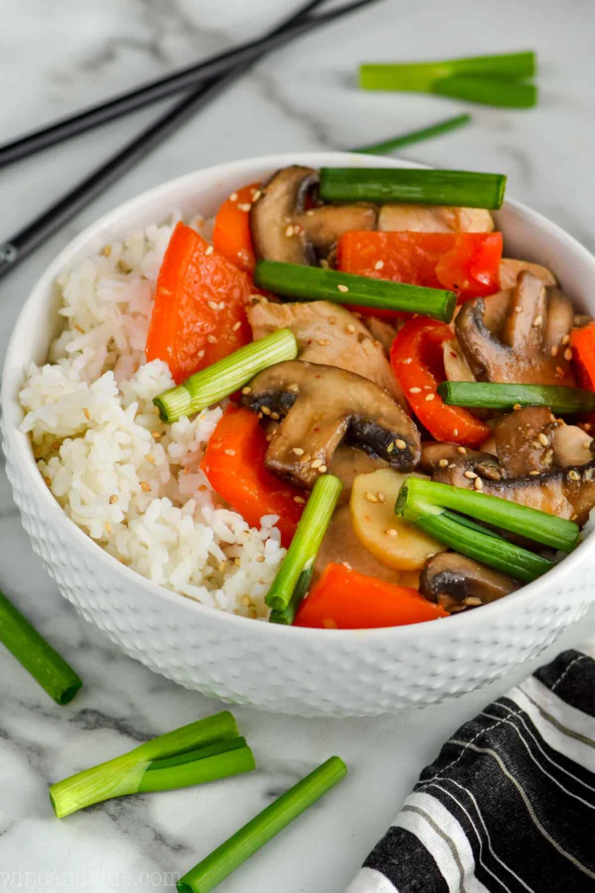 easy Szechuan chicken in a bowl over rice