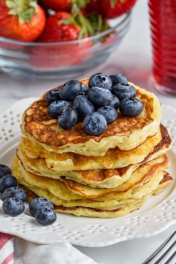 pile of yogurt pancakes with fresh blueberries on top