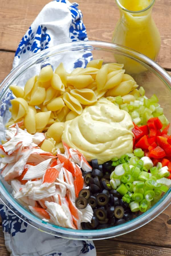 This Crab Pasta Salad is a family recipe, one of my favorites! Packed with veggies and delicious flavor, it's a staple at summer BBQs!