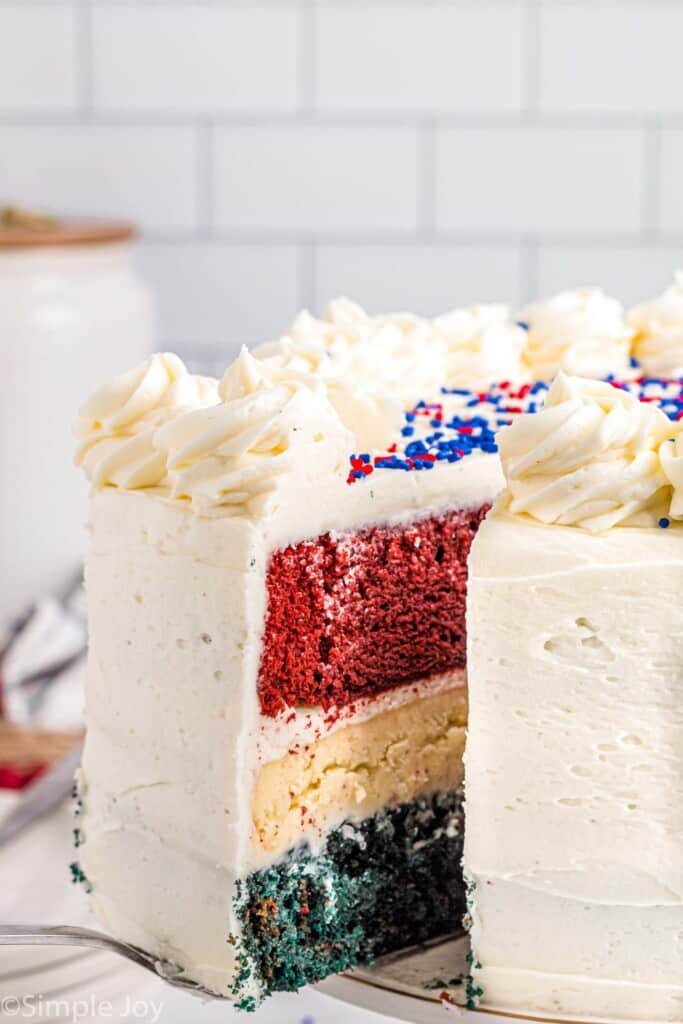 a flag cake with a slice coming out