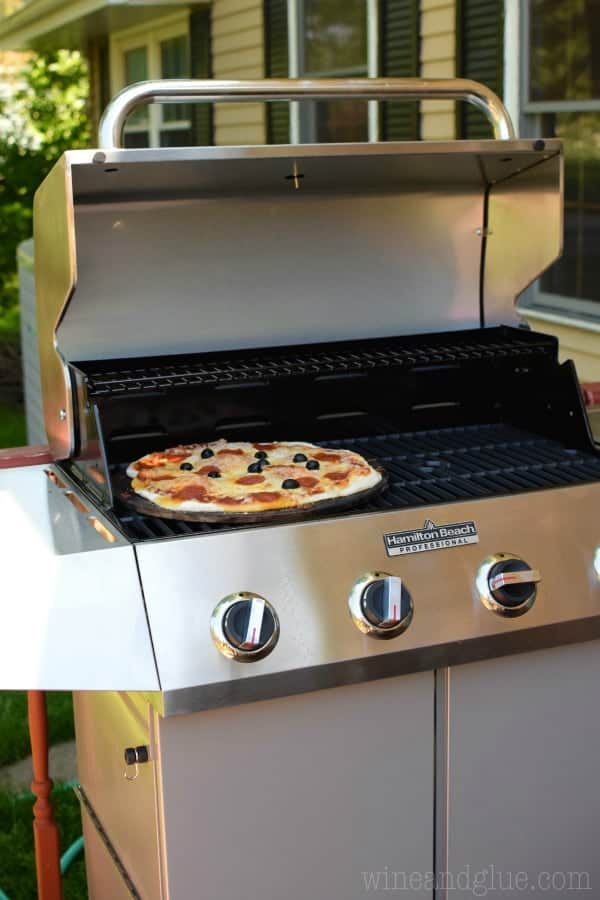 How to Make Pizza on the Grill! This is our absolute favorite way to make pizza, and we do it once a week in the summer.
