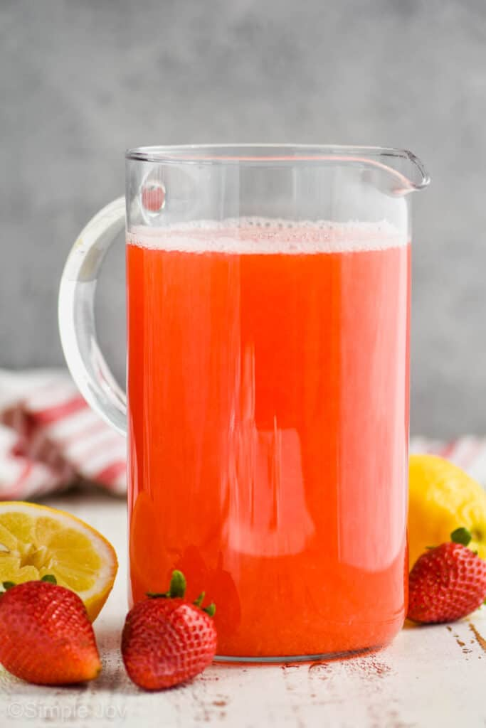 large glass pitcher of strawberry lemonade