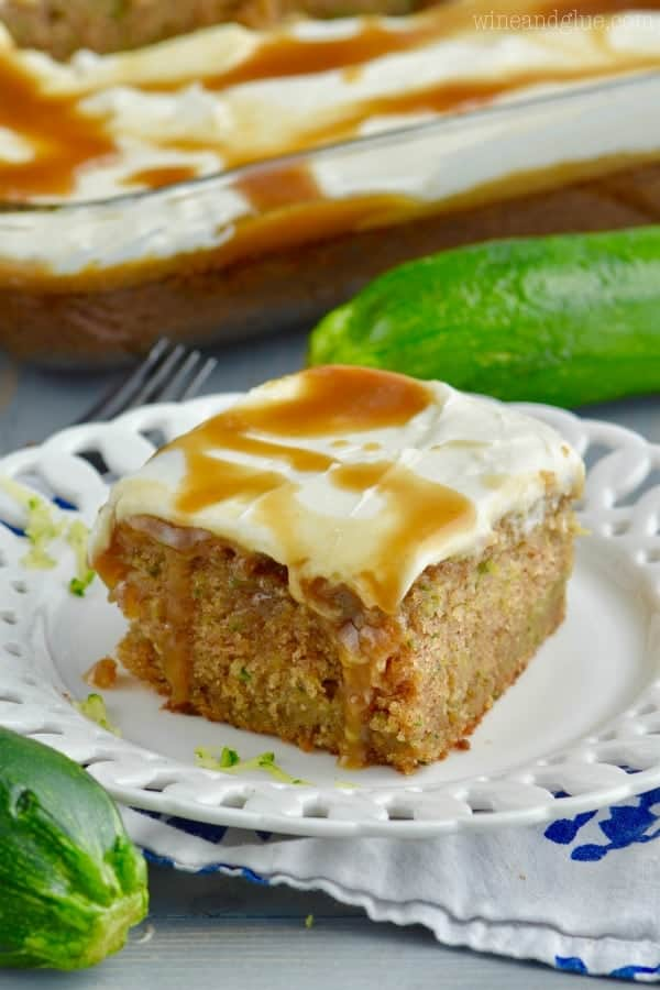 The Caramel Zucchini Poke Cake has a cream layer and drizzled with caramel.