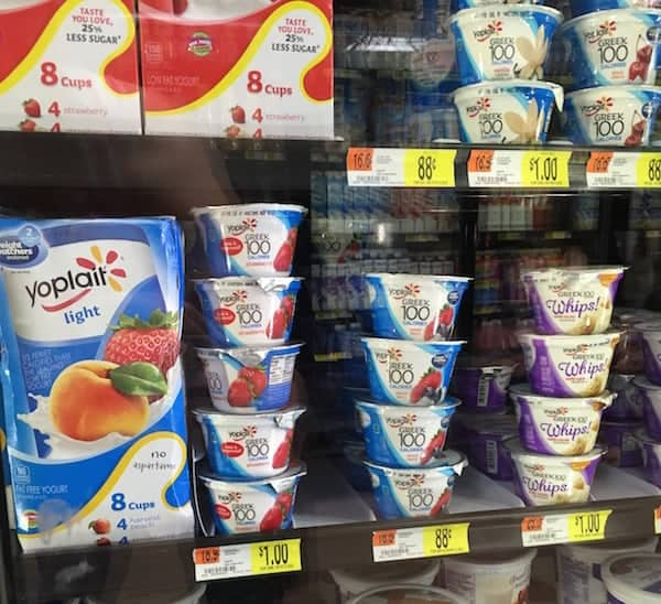 Stacks of light Yoplait yogurt flavored peach and strawberry at the grocery store.