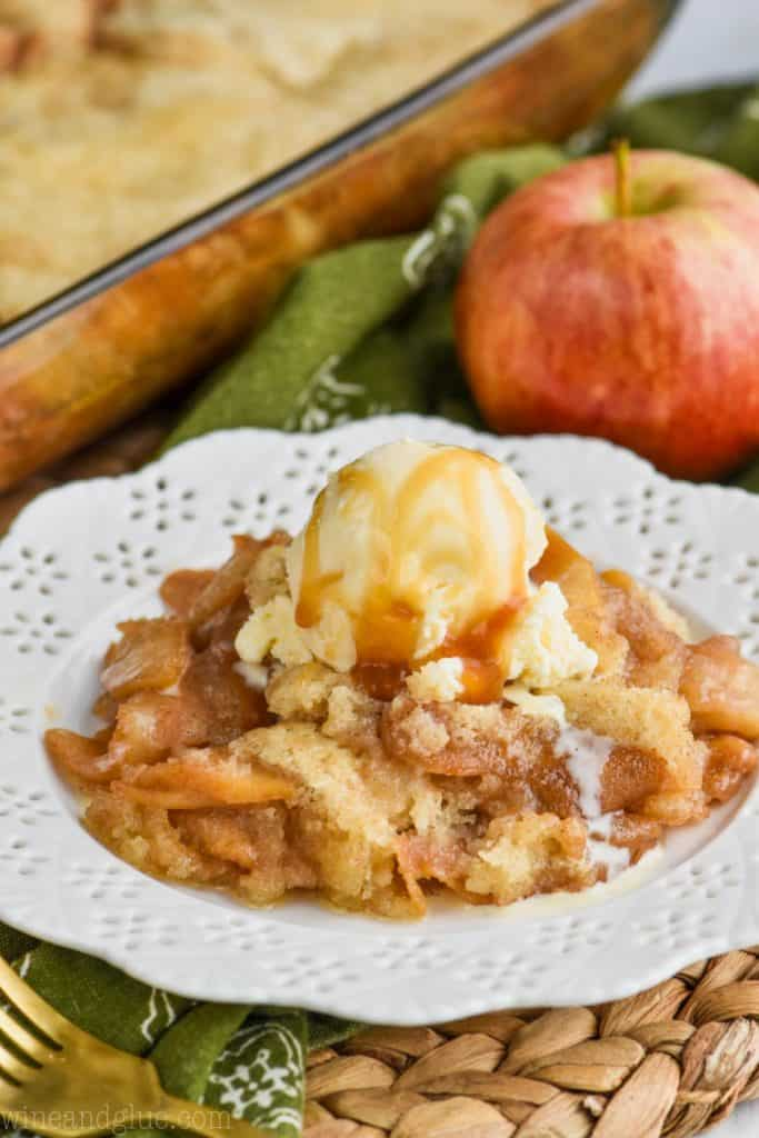 easy apple cobbler recipe on a white plate with vanilla ice cream and caramel sauce