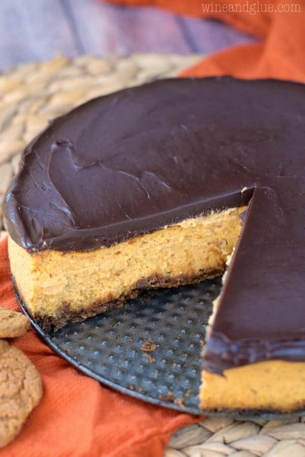 This Pumpkin Cheesecake is insanely smooth, pumpkiny, and delicious with a gingersnap crust and a deeply rich and smooth chocolate ganache top! A keeper for sure!