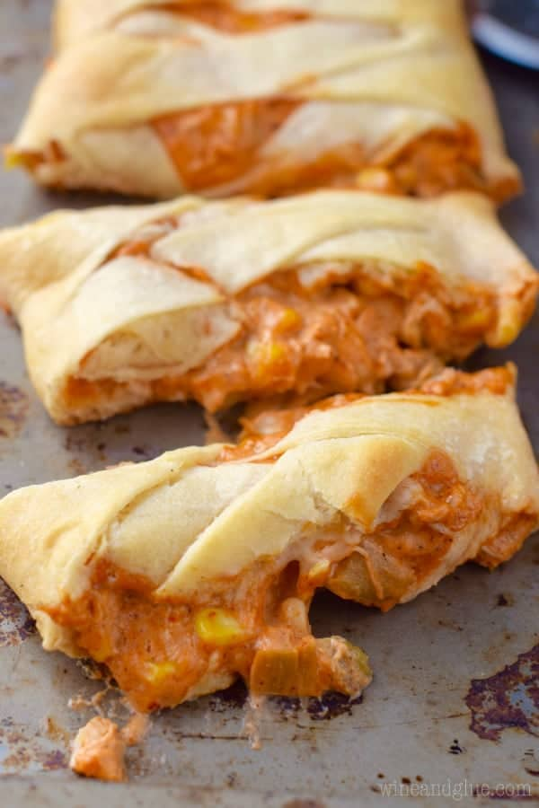 Chicken Enchilada Crescent Braid cut into slices on a baking pan.