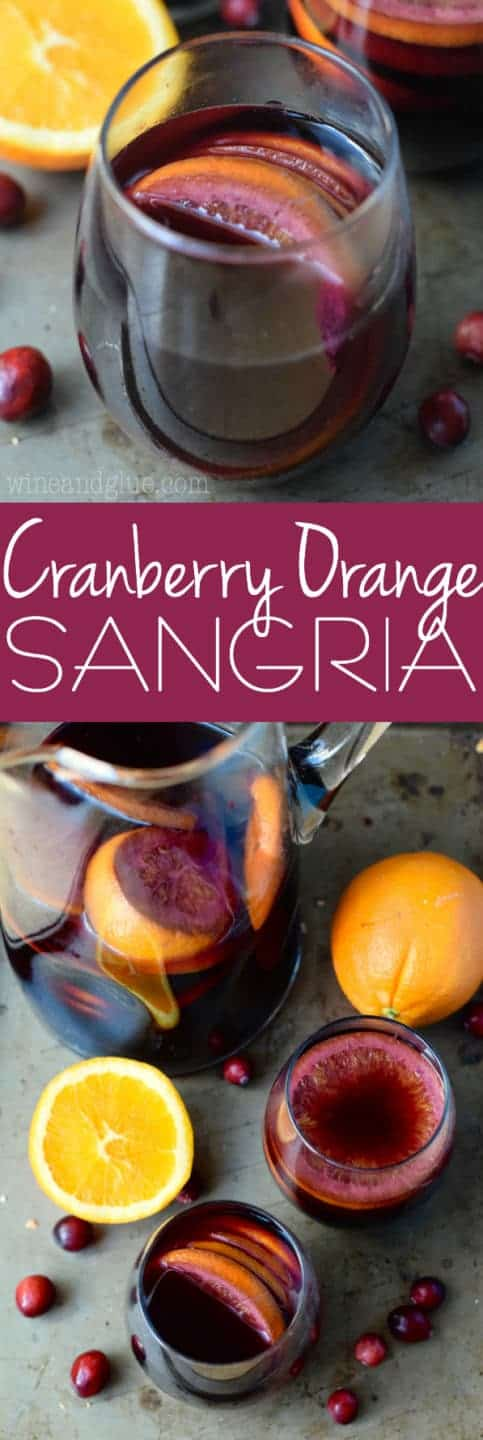 The Cranberry Orange Sangria are in a tumbler wine glass with a dark purple complexion.