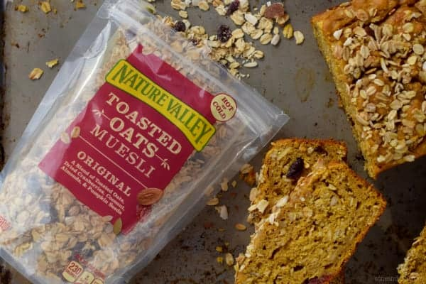 Slices of the Muesli Pumpkin Bread is next a package of the Nature Valley Toasted Oats Muesli.