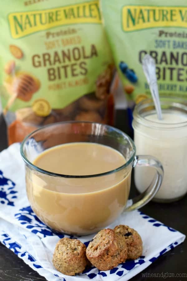 In a glass mug, some coffee is mixed with the Vanilla Bean Creamer and eaten with the Nature Valley Granola Bites