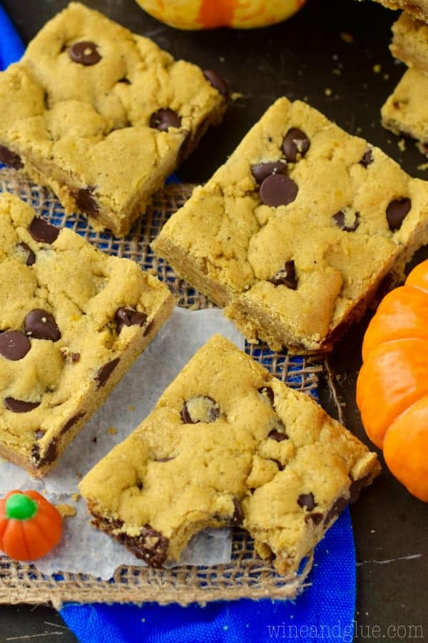 An overhead photo of the Pumpkin Brown Butter Cookie Bars that are shaped as little squares with dots of chocolate chips.