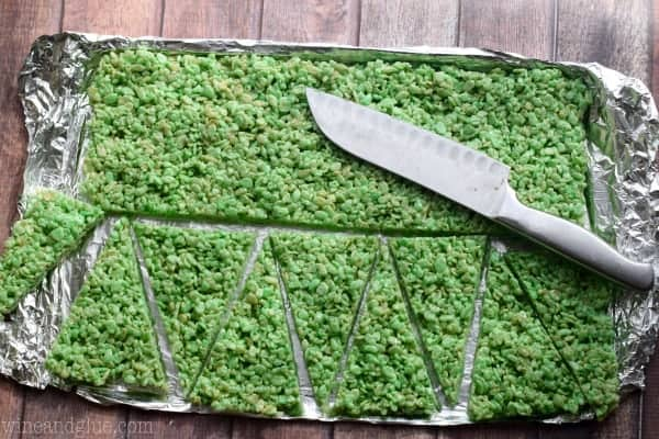 On a baking sheet, the green Rice Krispies was cut horizontally and then into little triangles.