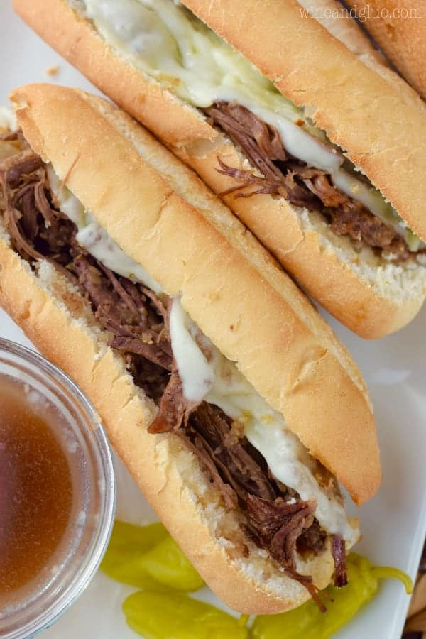 These Slow Cooker French Dip Sandwiches are easy and packed with flavor! Perfect for an easy weeknight meal or to feed a crowd!