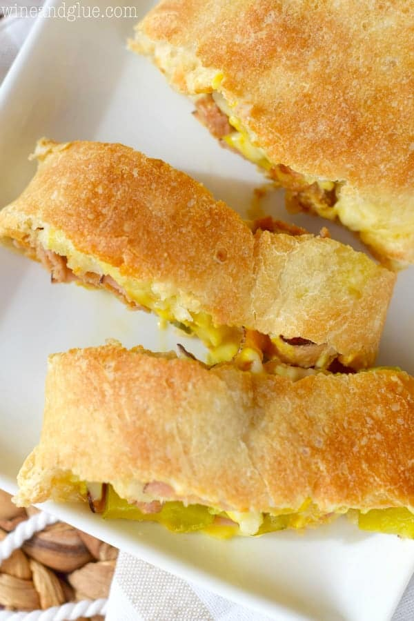 An overhead photo of rectangular pieces of the Cuban Stromboli showing some of the mustard and cheese oozing out.