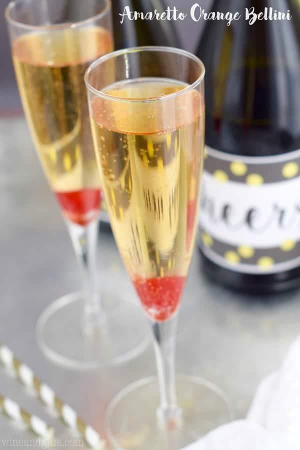In champagne flukes, the Amaretto Orange Bellini has a maraschino cherry a the bottom of the glass as garnish.